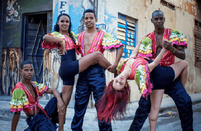 cuban salseros posing in the street