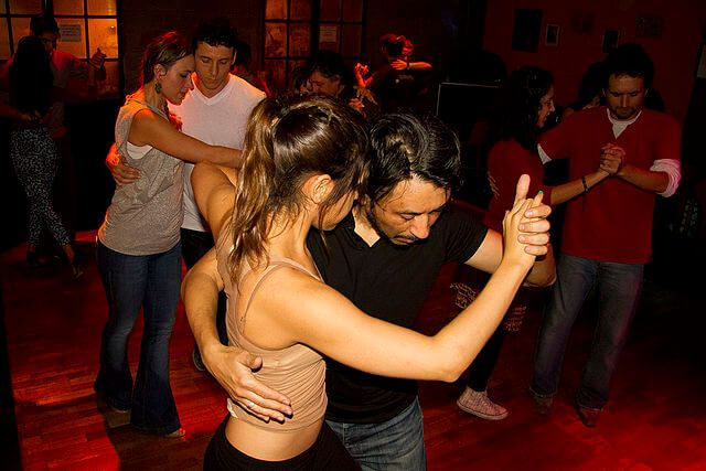 several couples dancing salsa