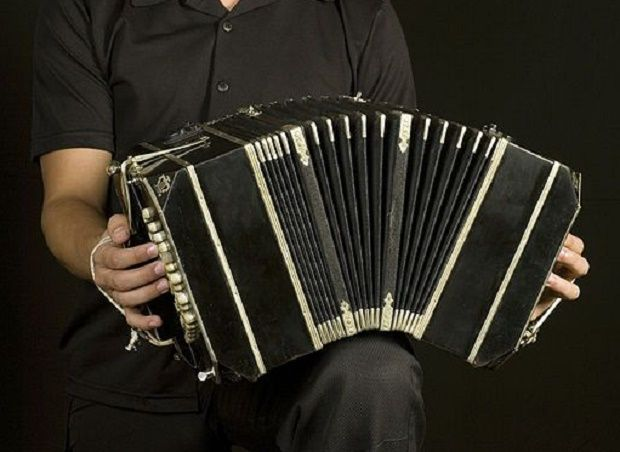 a man playing a bandoneon