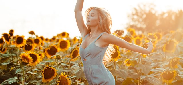 Womman Dancing in A Field of Sunflowers