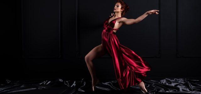 Woman-Dancing-in-a-Draping-Dress.jpg