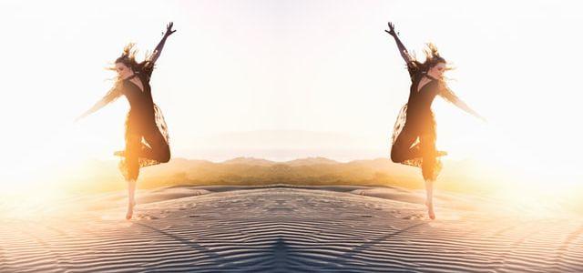 Woman Dancing on the Sand